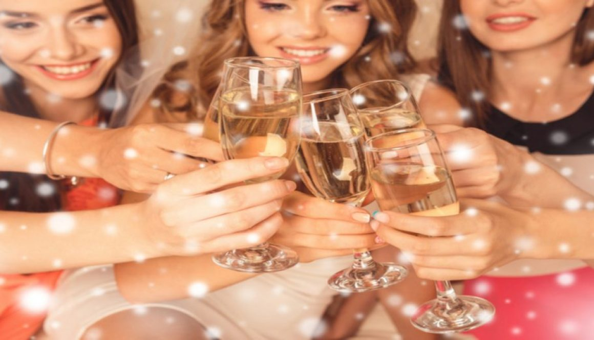 Close up of happy girls celebrating new year party